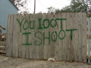 Message on fence beside the Biloxi, Mississippi, Community Center.